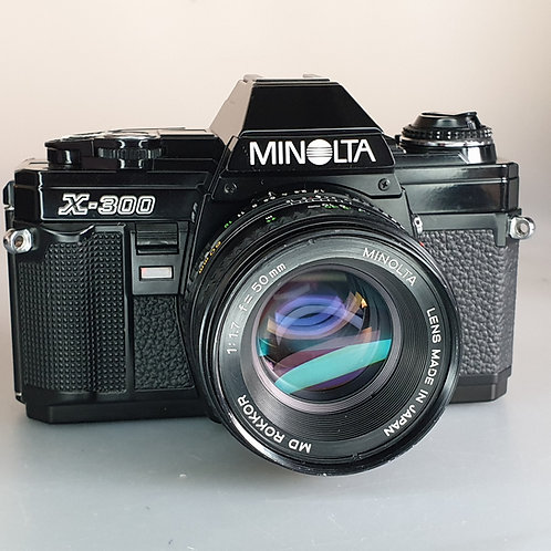 Minolta X300 Black cover with ROKKOR 50mm 1.7 MD lens. Beautiful condition.