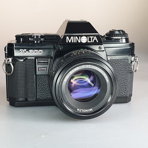 Minolta X300 Black cover with 50mm 1.7 MD lens. Beautiful condition.