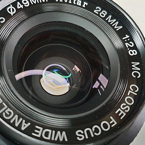 Vivitar  28mm f: 2.8 MC Wide angle Close focus lens Minolta MD mount.