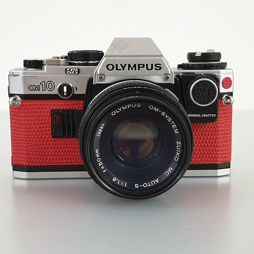 Olympus OM10 with Zuiko MC  Auto-S 50mm 1.8. Reskinned in red