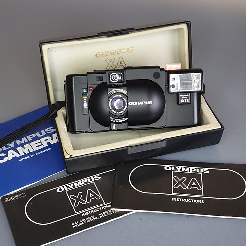 Olympus XA. Superb condition, with Box & Manuals
