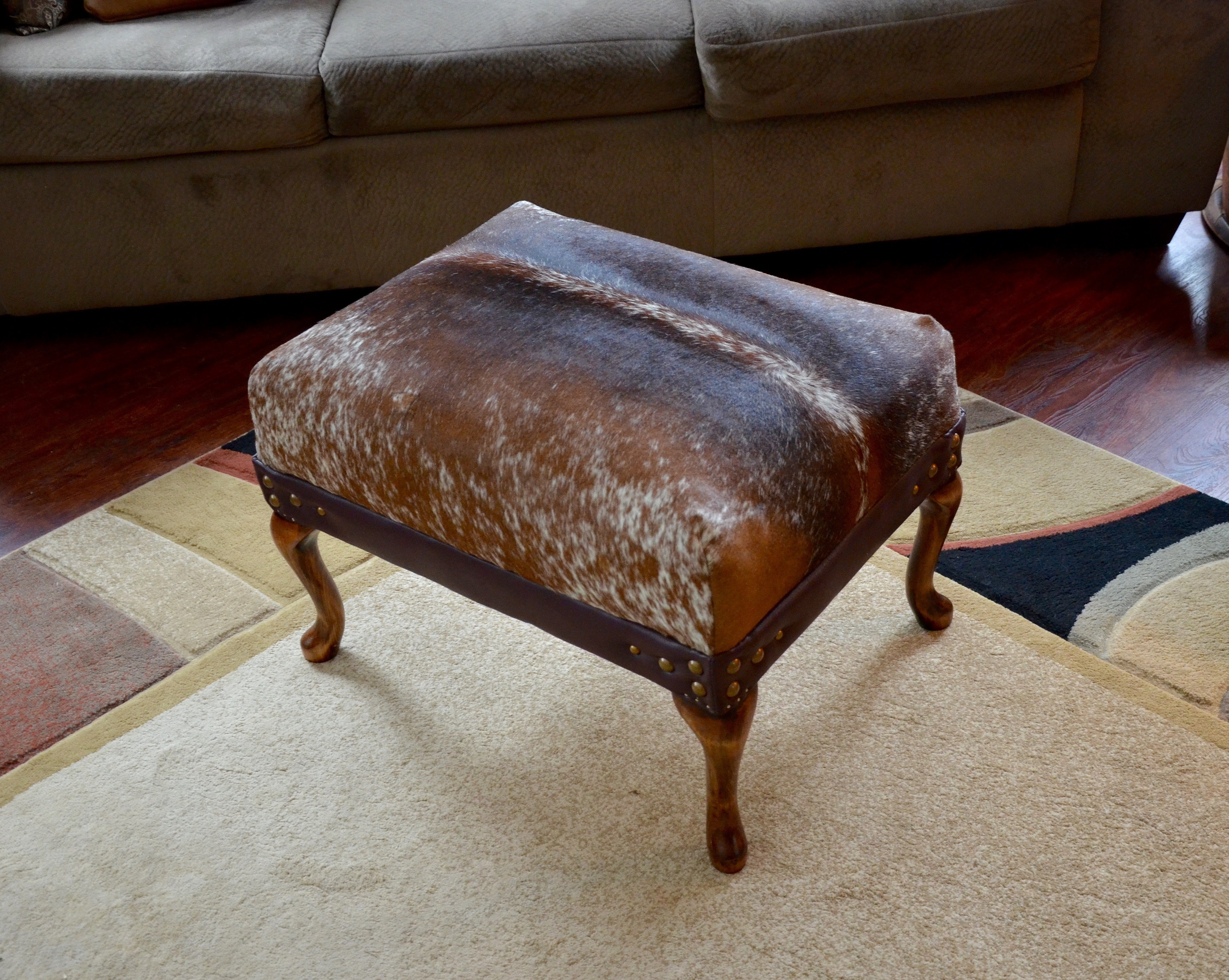 cowhide product chairish green ottoman