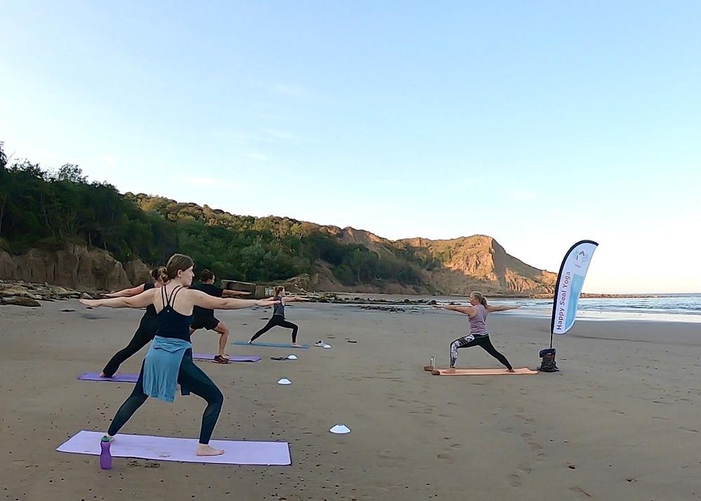 Yoga on the beach Cayton Bay