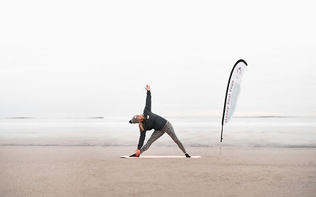Helen Peterson Happy Seal Yoga Teacher Trikonasana Triangle Pose on the beach