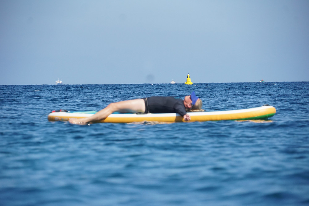 SUP yoga Savasana pose