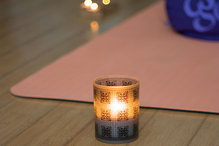 Yoga mat and candle private practise