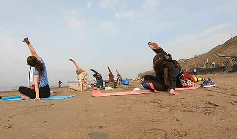 Yoga on the beach at Whitby, North Yorkshire
