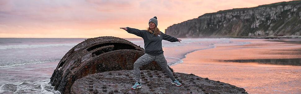 Helen Peterson Happy Seal Yoga teacher and owner sunrise warrior 2 Bempton Cliffs