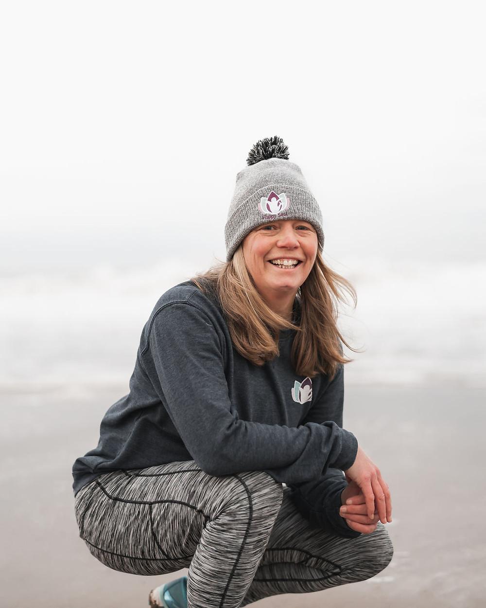 Helen Happy Seal Yoga Teacher in grey Happy Seal Yoga beanie, blue happy seal yoga sweatshirt and grey sugar pocket leggings