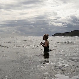 Swimmer entering the water at Cayton Bay, North Yorkshire