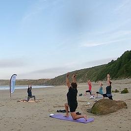 Yoga on the beach at Cayton Bay