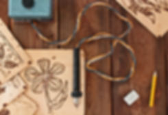 A pyrography tool and a floral model..j