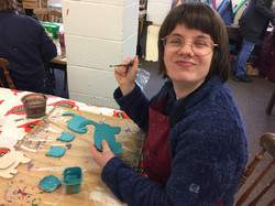 Alex has been with us for 12 years. She loves being with her friends at the workshops.