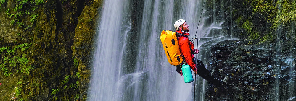 Sea to Summit dry bag abseiling down waterfall