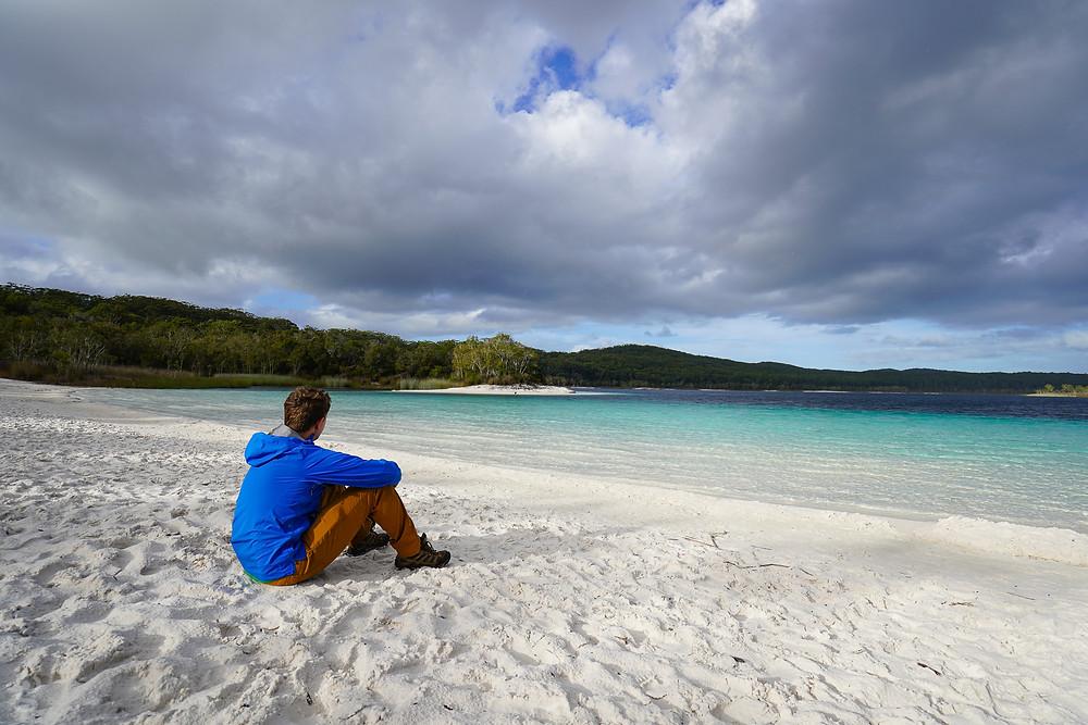Visitor looking at Lake McKenzie on Fraser Island