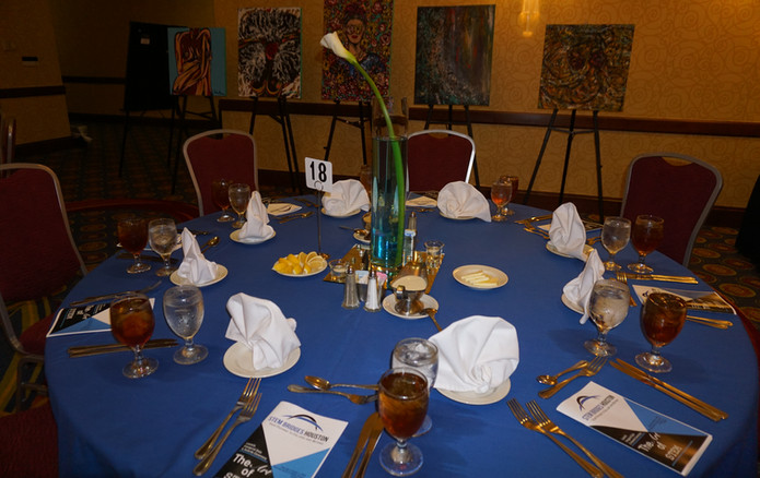 Table Setting with Art in the Background