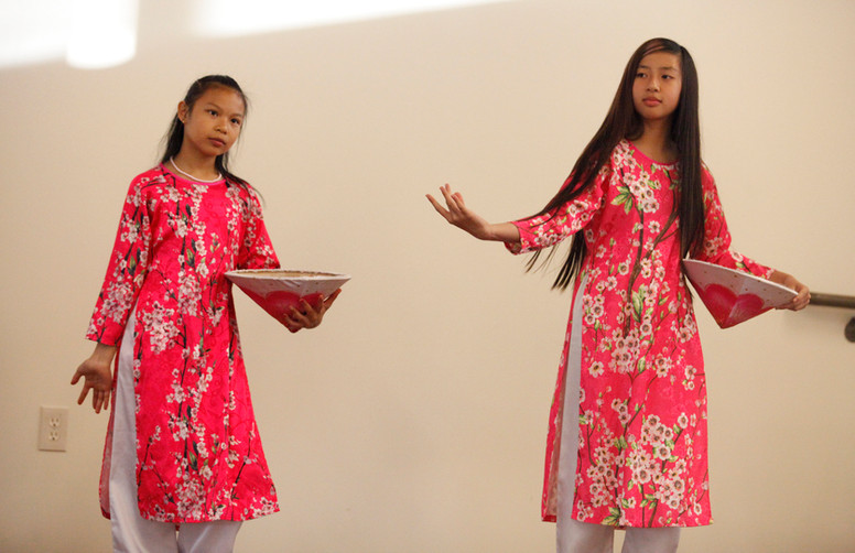 Participants from the Vietnamese cultural group perform a traditional dance at World Refugee Day in Campbell, Santa Clara, on June 14.