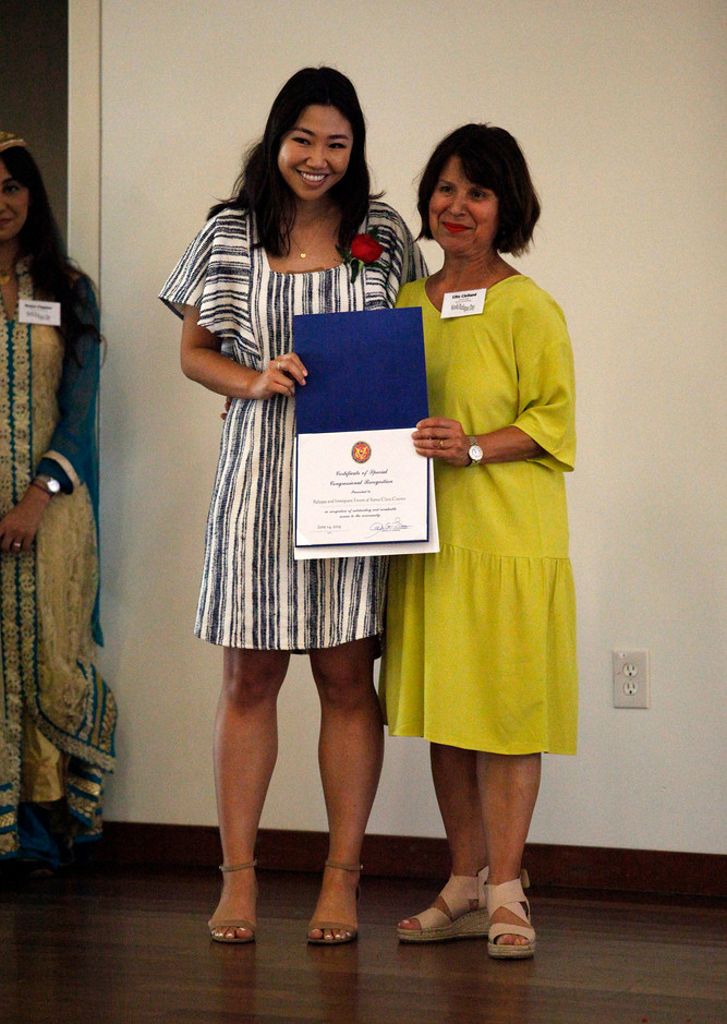 Crystal Yu, Field Representative for Congresswoman Anna G. Eshoo, poses for a picture with award recipient Ellie Clelland of the Refugee and Immigrant Forum of Santa Clara County. The award recognizes the community organization and its efforts in preparing the celebration of World Refugee Day in the Campbell Community Center on June 14.