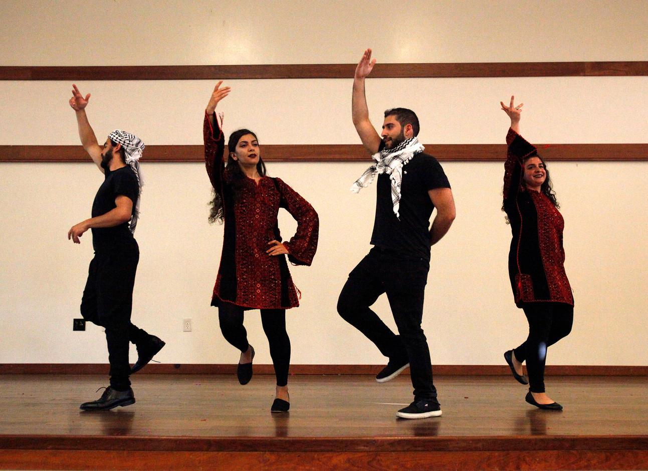 (left to right) Wassim Hage, Deellan Khanaka, Ahmad Merhebi, and Jana Kadah perform a traditional line dance from Levant called Dabke at World Refugee Day in Campbell, Santa Clara, on June 14.