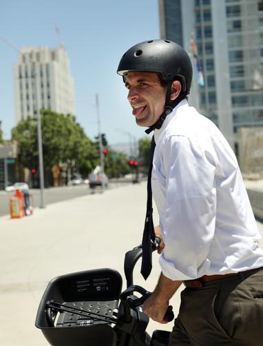 Mayor Sam Liccardo takes a test drive on the new Ebike introduced by Lyft. (Camille Gandotra/Mosaic)