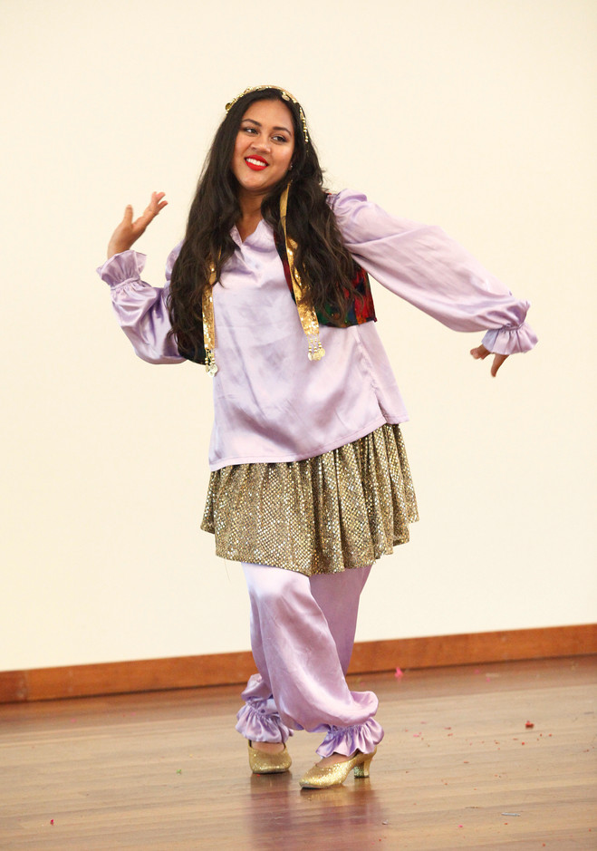 Jasmine Fathi, from the Beshka Dance Academy, flicks her wrists as she performs a traditional Persian dance for the 27th annual World Refugee Day celebrated in the Campbell Community Center on June 14.