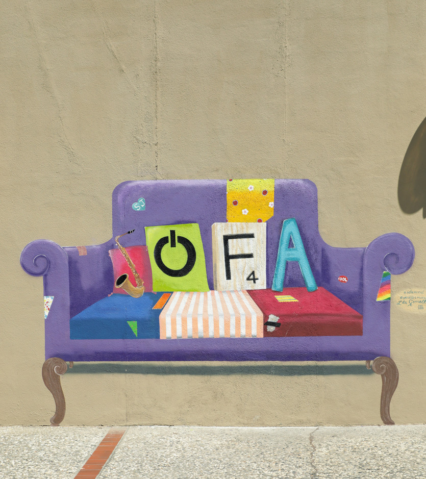 Artist Lila Gemellos plays with the term SoFA (South of First Area) in a mural painted on a wall of the Valley Title building on First Street. (Camille Gandotra/Mosaic)