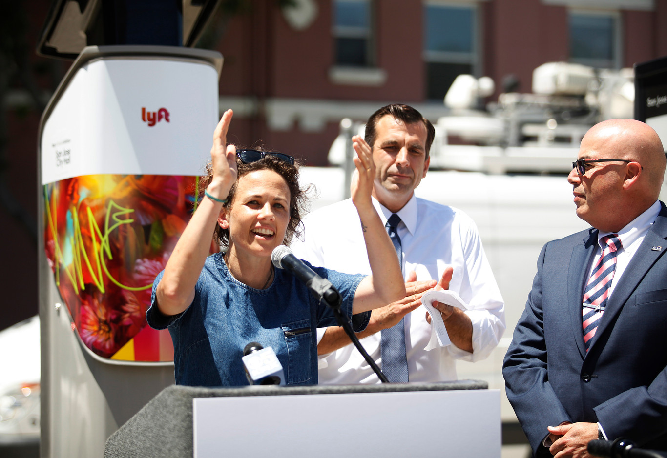 Caroline Samponaro, Lyft's head of micro mobility policy, and San Jose Mayor Sam Liccardo celebrate the launching of affordable eBikes in San Jose (Ruth Abigail Gonzalez/Mosaic).