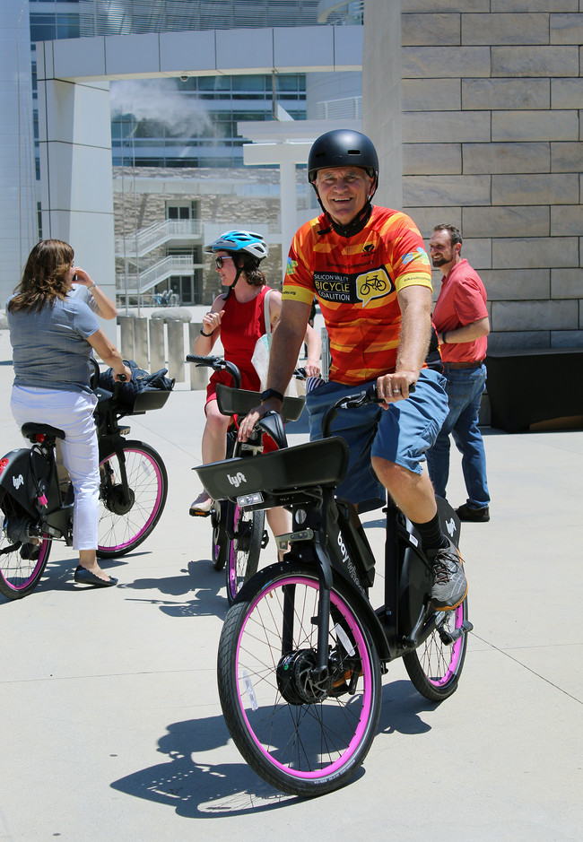 John Cordes, a member of the Silicon Valley Bicycle Coalition, rides on the new Ebike introduced by Lyft at press conference at San Jose City Hall Plaza. (Kim Mitchell/ Mosaic)