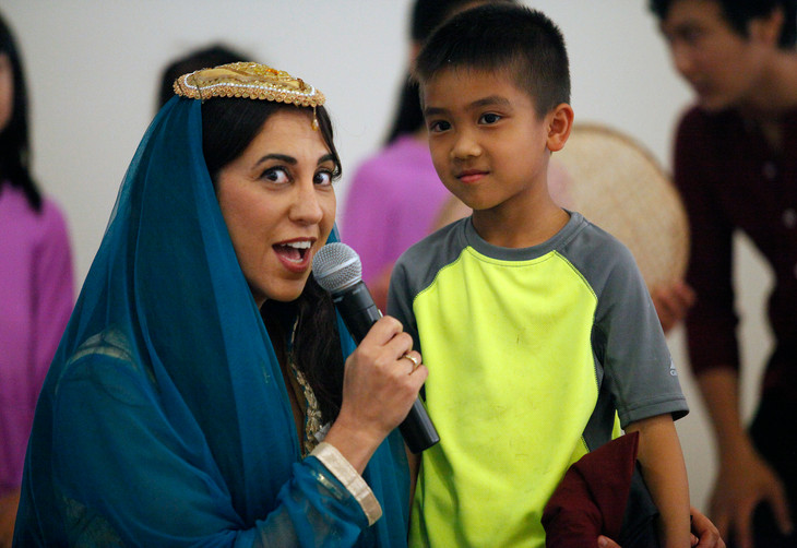 Master of Ceremonies Renee Paquier talks to a performer from the Vietnamese dance group at World Refugee Day in Campbell, Santa Clara, on June 14.