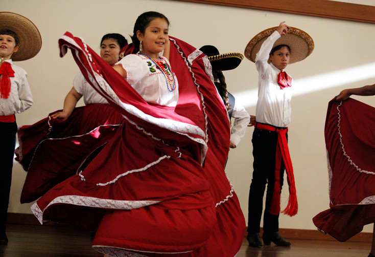 Twirling in handwoven traditional garments, youth participants perform a folkloric dance from Guadalajara, Mexico, at World Refugee Day in Campbell, Santa Clara, on June 14.