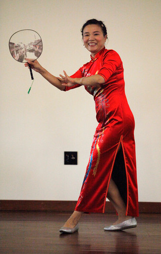 Dressed in a traditional qipao, a dancer performs a Chinese cultural dance at World Refugee Day in Campbell, Santa Clara, on June 14.