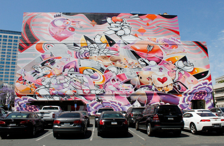A mural painted on a wall of the Valley Title building overlooks a parking lot on First Street in San Jose. (Abel Angel Gonzalez/Mosaic)