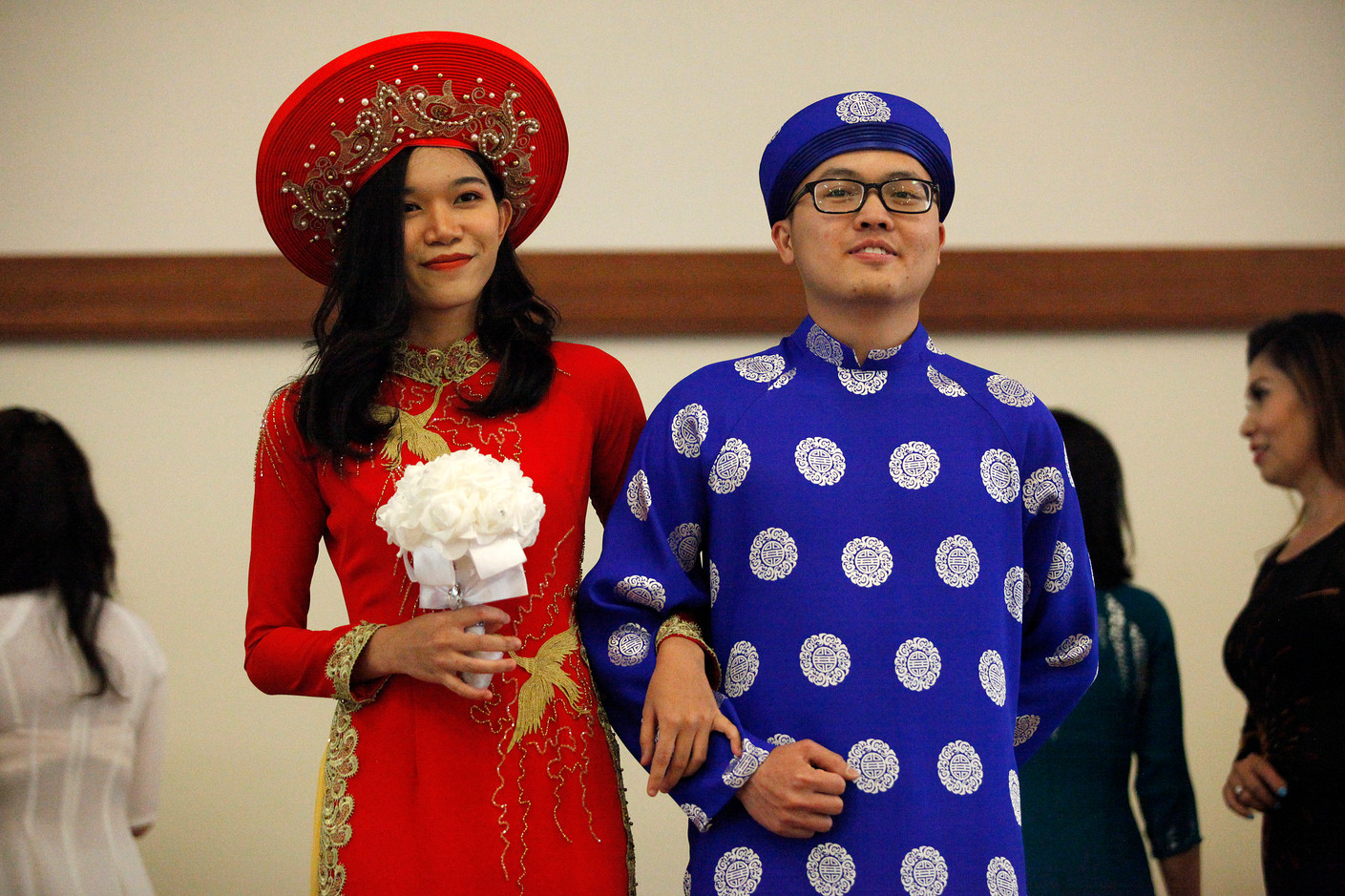 Participants in the 27th annual World Refugee Day, hosted at the Campbell Community Center, model traditional Vietnamese wedding garments in an ethnic clothing fashion show on June 14.