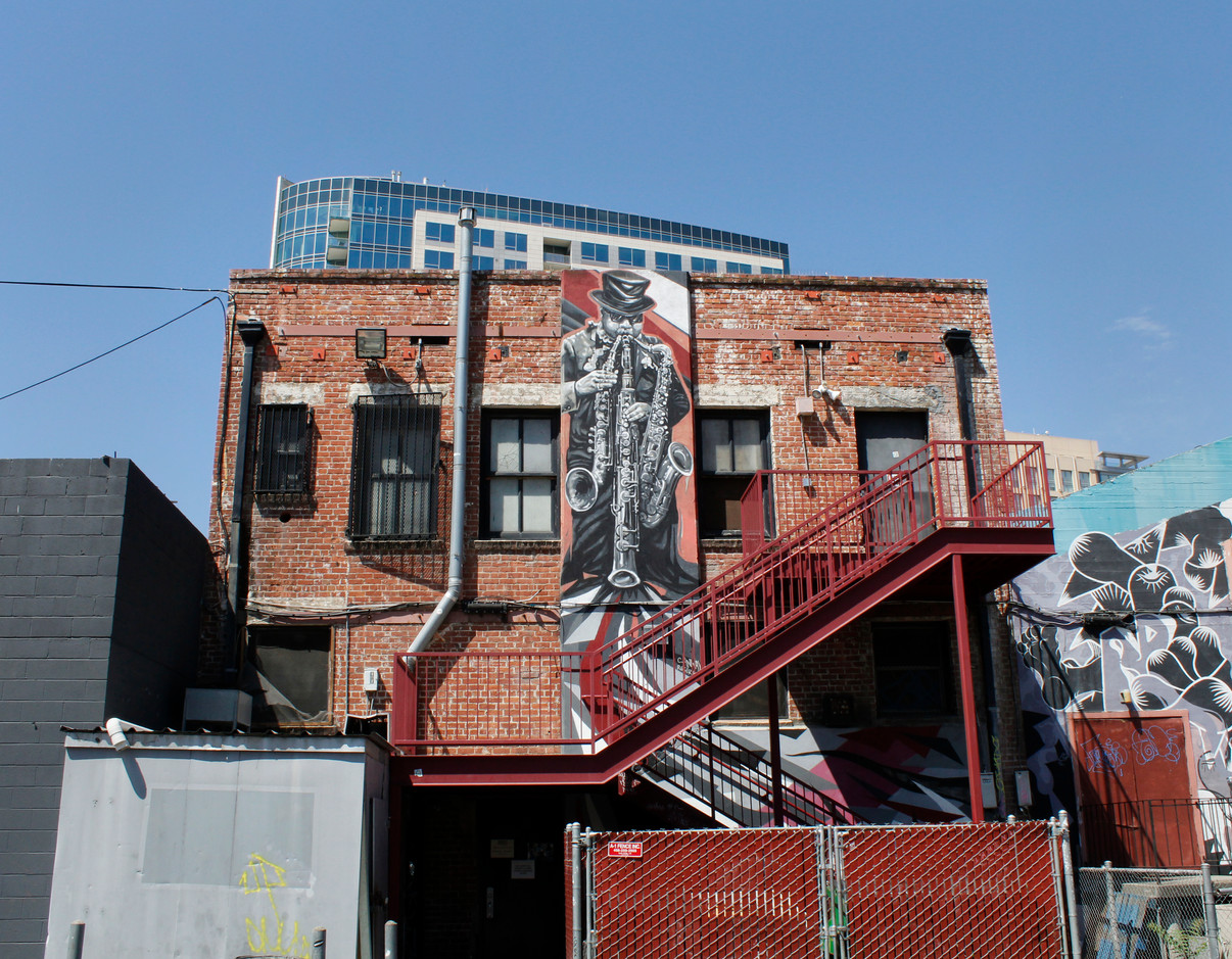 A mural depicting a saxophone player decorates the back of a building on First Street. (Abel Angel Gonzalez/Mosaic)