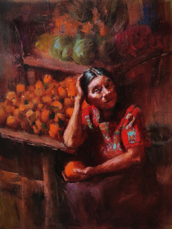 Mexican woman selling oranges