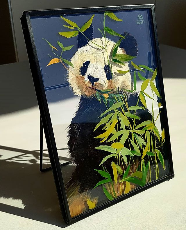 Panda hiding behind the bamboo