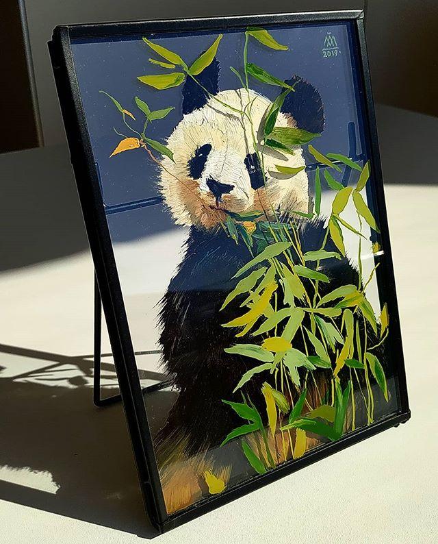 Panda hiding behind the bamboo
