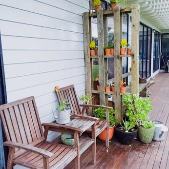 5. Porch Chair + Coffee Table Unit + Palette + Decorative pot plants + fairy lights