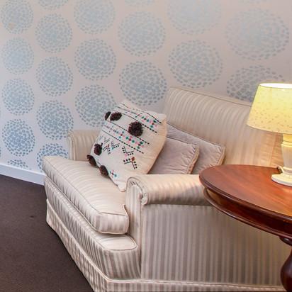 4. large creme armchairs