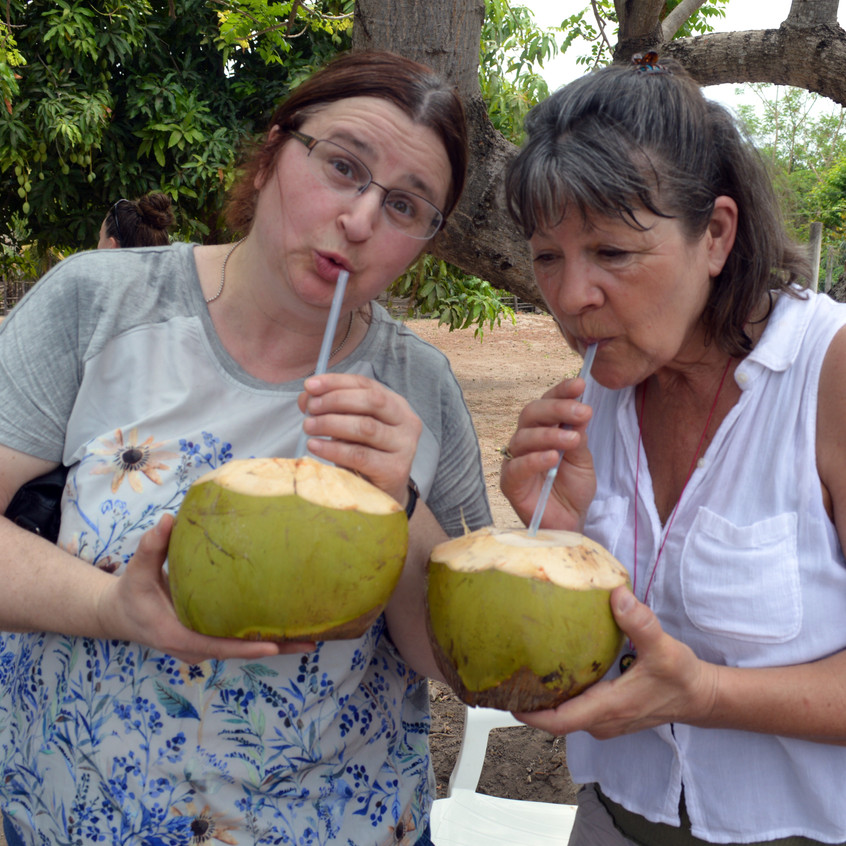 Rose and Dona enjoying a coconut.