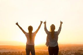 Image_2 women arms in air at sunrise.jpg