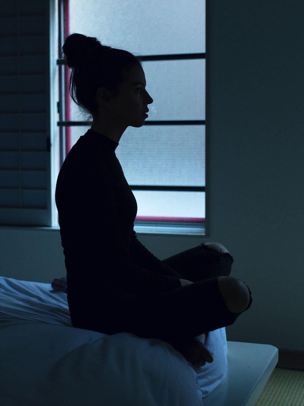 woman sitting in bed mindful