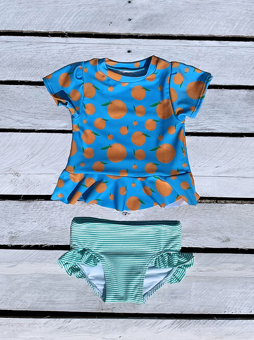 Squeeze the Day Short Sleeve Skirted Rash Guard and Ruffle Swim Bottom Set