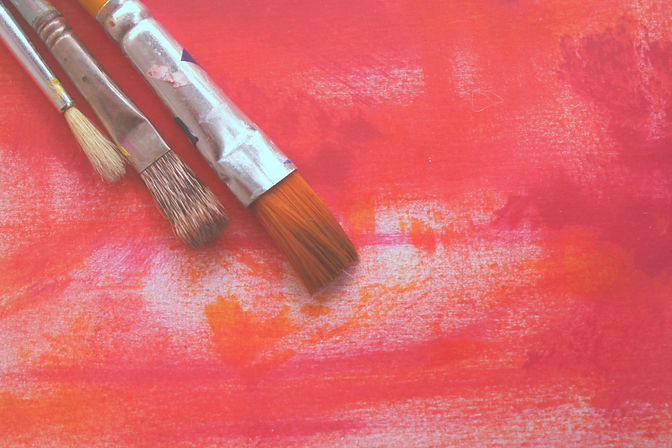 Paint brushes on canvas