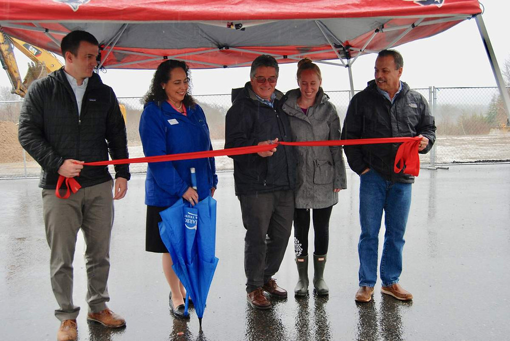 Andes Variety owner Craig Stewart, center, cuts the ribbon to celebrate the beginning of construction of a new, larger store at 1625 Atlantic Highway in Warren. Also shown, from left, are project manager Brandon Cummings, Bar Harbor Bank & Trust Vice President Larissa Darcy, Stewart's daughter, Nellie Kavanagh, and Wes Thames of Priority Real Estate Group.