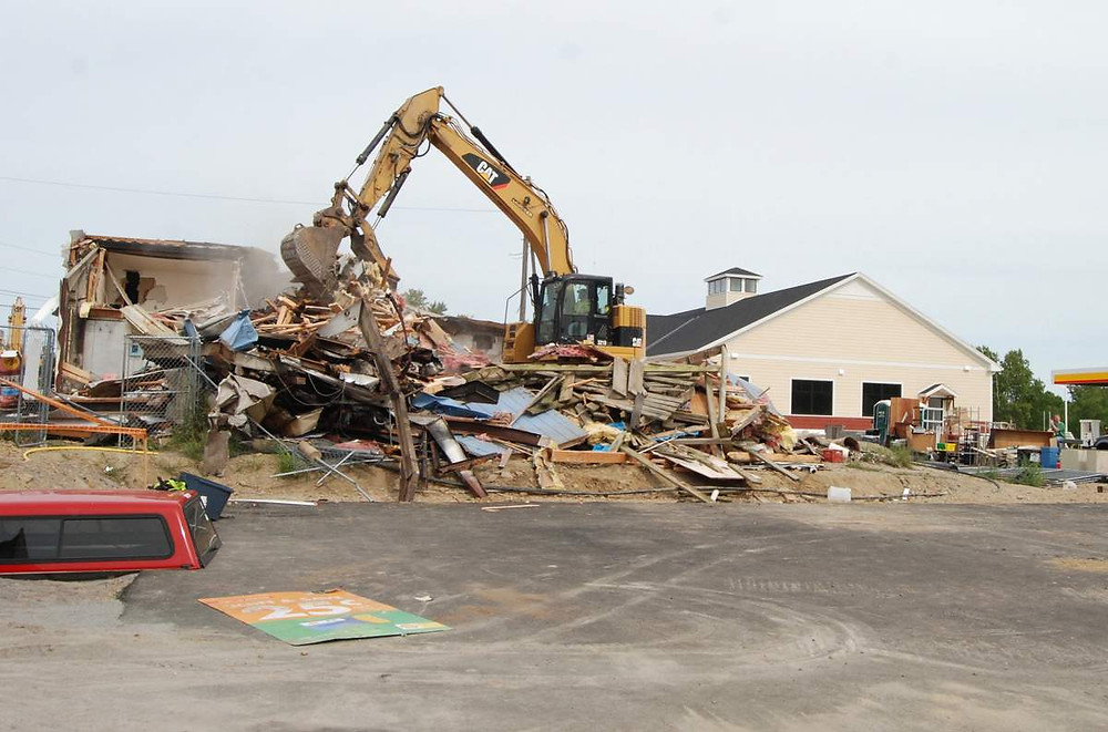 Construction crews work to bring down the old Andes Variety in Warren Sept. 10, while others work inside the new, larger location at 1625 Atlantic Highway.