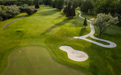 Aerial view of a beautiful green golf co