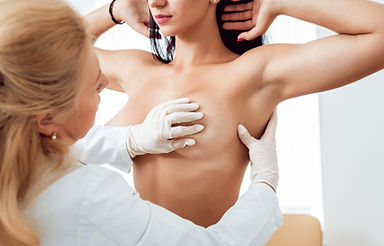 doctor-get-examining-breast-young-woman.