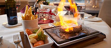 Fleisch auf heissem Stein im Restaurant ROMA im Herzen von Naters.