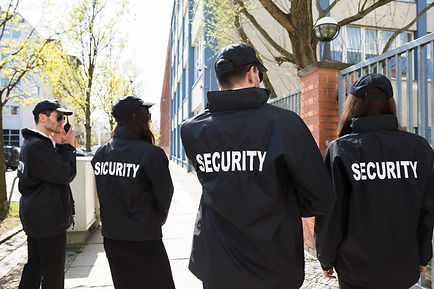 Rear View Of Security Guards In Black Un